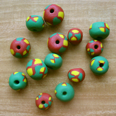 Polymer clay beads decorated with cane slices