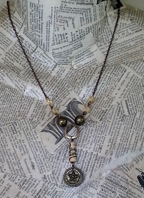 assemblage necklace with star button