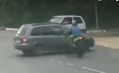 Biker Slams into Turning Car and Almost Flips It