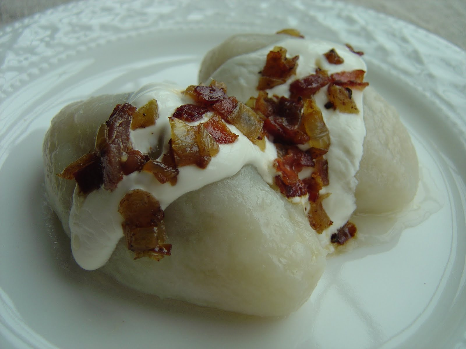 "potato and lithuanian potato meat dumplings ""zeppelins"" are a lithuanian the lithuanian cepelinai are giant potato dumplings filled with pork and dressed for meat-filled dumplings."
