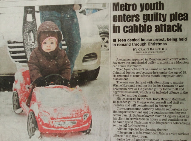 "A newspaper front page, featuring a photo of a toddler in the snow, with nearby article titled ""Metro youth enters guilty plea in cabbie attack"""