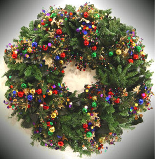 Christmas lights decorated to X mas wreath and decoration of baubles,mistletoe,bells picture