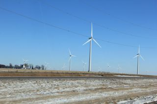 photo of wind turbines to the horizon