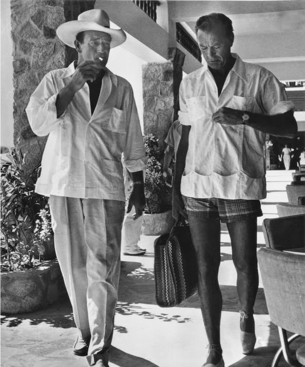 John Wayne visited with Gary Cooper.