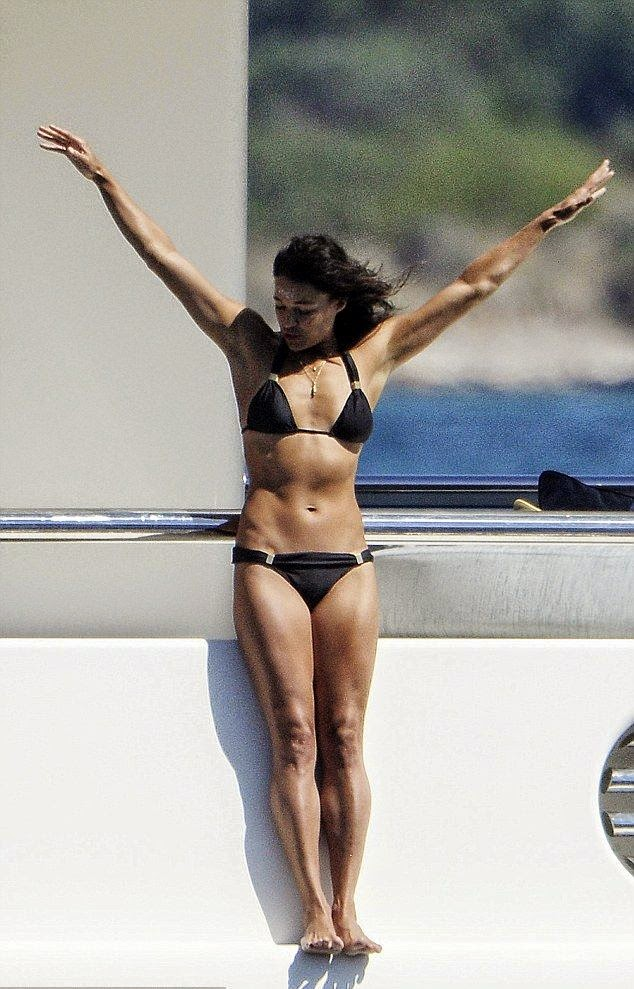 That's right, the 36-year-old translated her grew-up to work something out from the most female habituality as she shacked her black bikini body to jumping from the luxury yacht into the Balearic sea on Wednesday, August 6, 2014.