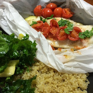 Tilapia with lemon and grape tomatoes in parchment