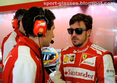 Fernando Alonso talking to his pit crew wearing Oakley Garage Rock Sunglasses