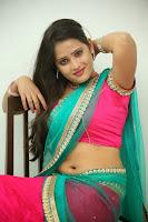 Anusha sizzling Pictures in half saree 066.JPG