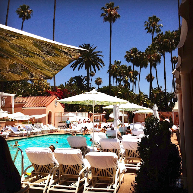 Beverly Hills Hotel Pool lounge chairs palm trees los angeles