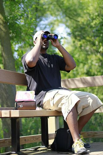 watching binoculars