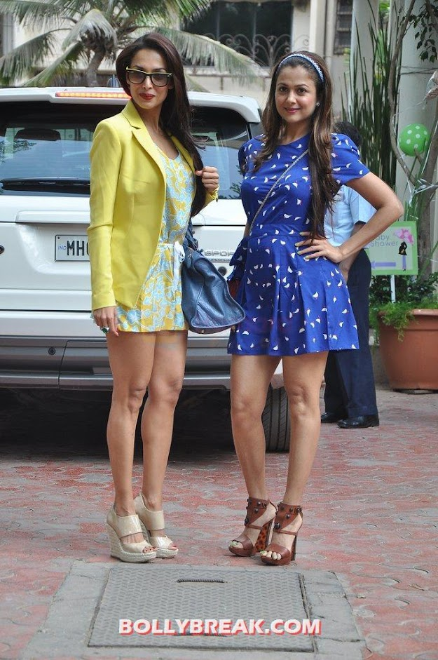 Malaika Arora in yellow blazer and Amrita in blue dress  - Malaika Arora Khan with sister Amrita Arora