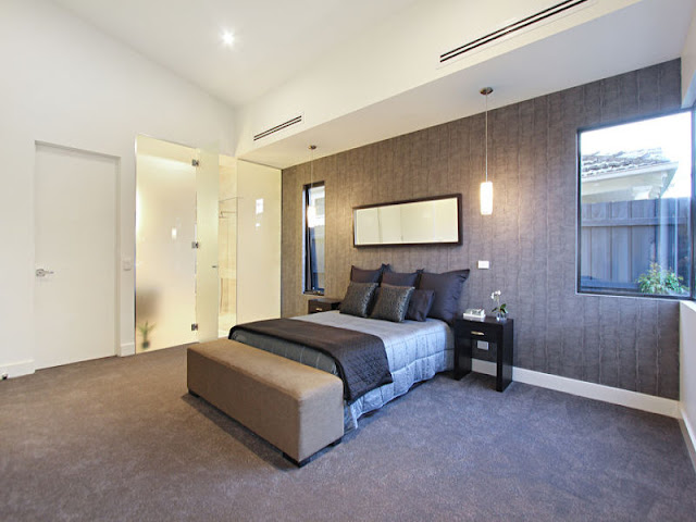 Picture of large brown bed in the master bedroom with brown wall