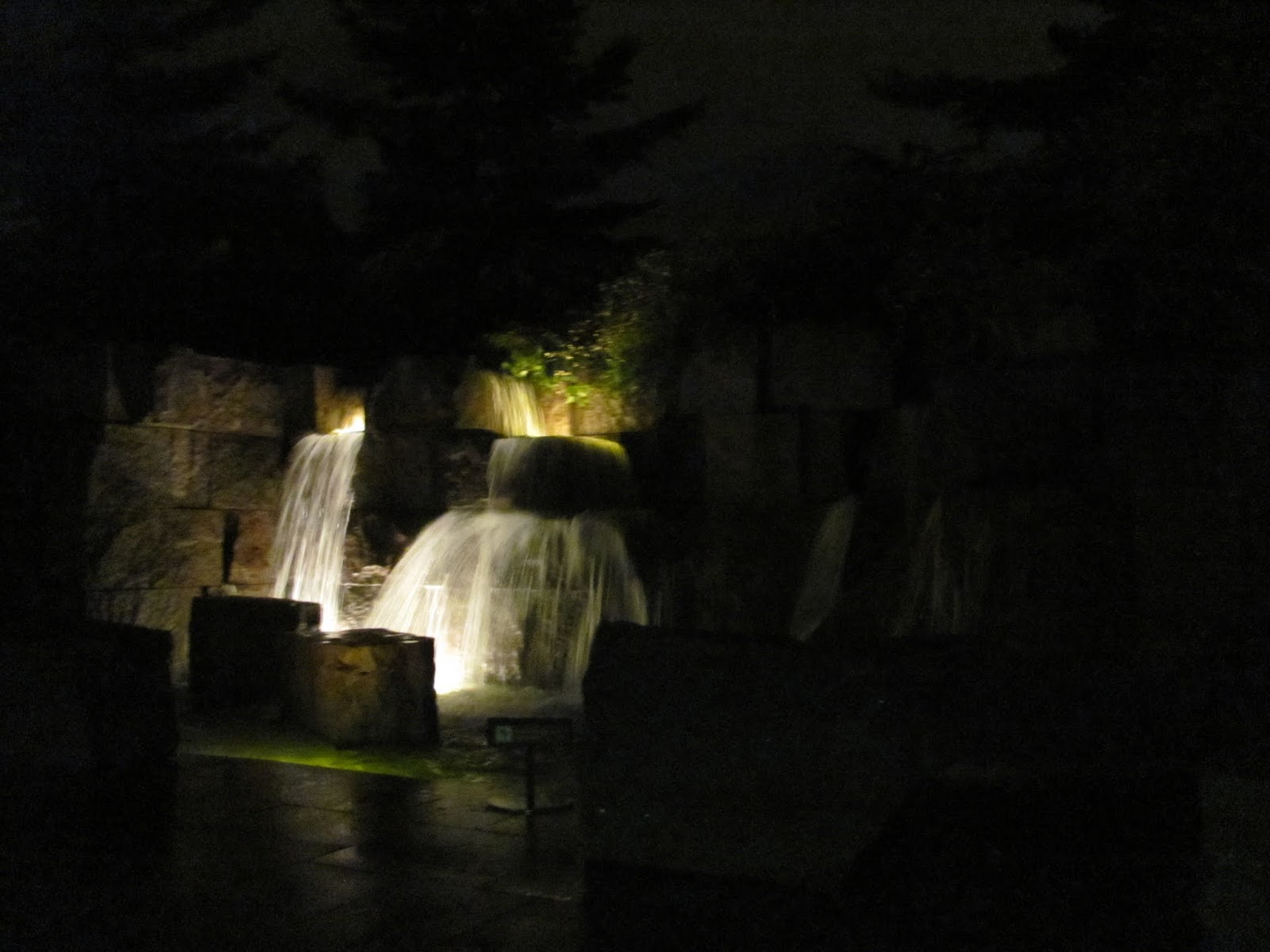 Nighttime shot of a lit fountain at the FDR Memorial in Washington, DC