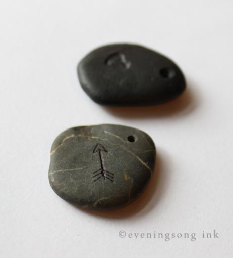 Eveningsong Ink carved beach stone arrow