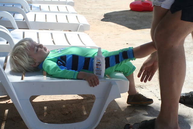 Anton getting sunscreened.