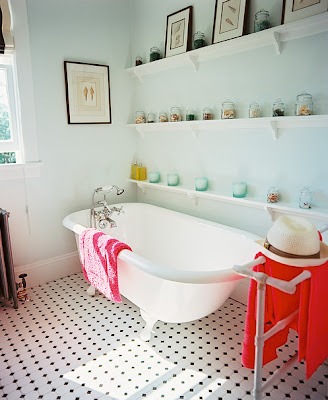 clawfoot tub in beach bungalow bathroom