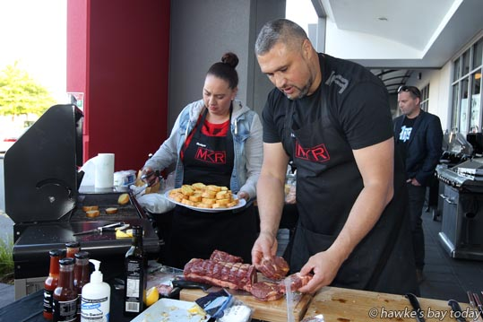 L-R: Monique Heke, Henry Heke, Flaxmere, Hastings, MKR My Kitchen Rules stars, cooking dinner outside Harvey Norman, Hastings, a promo by The Hits radio station, Harvey Norman, Hawke's Bay Seafoods and Holly Bacon Company. photograph