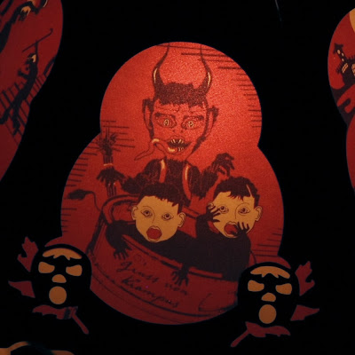 Limited edition lantern (close up) features 12 images of the Christmas devil Krampus