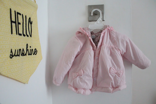 baby pink coat from tk maxx with bows on pockets and hood