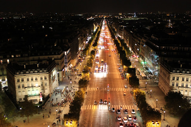 The busy nightlife of Avenue des Champs-Elysees was taken from the observation deck of Arc de Triomphe in Paris, France