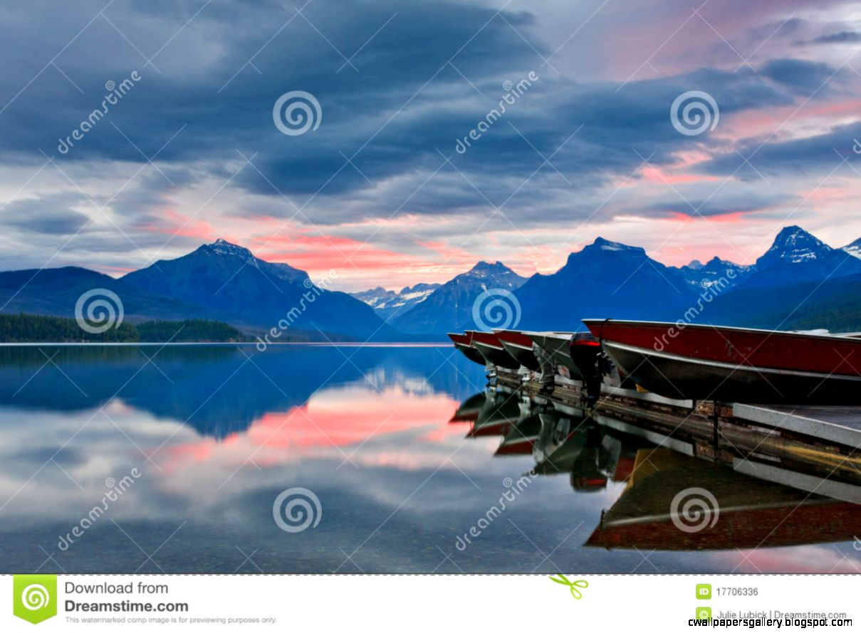 Pink Sunrise On Calm Mountain Lake Royalty Free Stock Image
