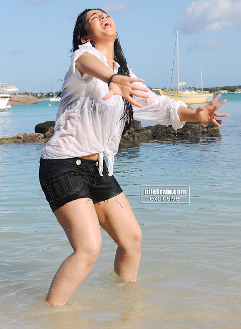 Charmi playing in water