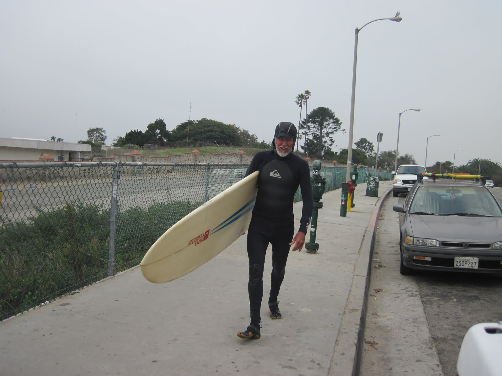 old guy surfers
