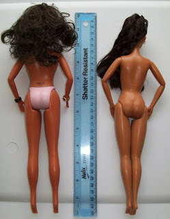 Back view Play Along Cheetah Girl Galleria (l) and Mattel Raven (r)