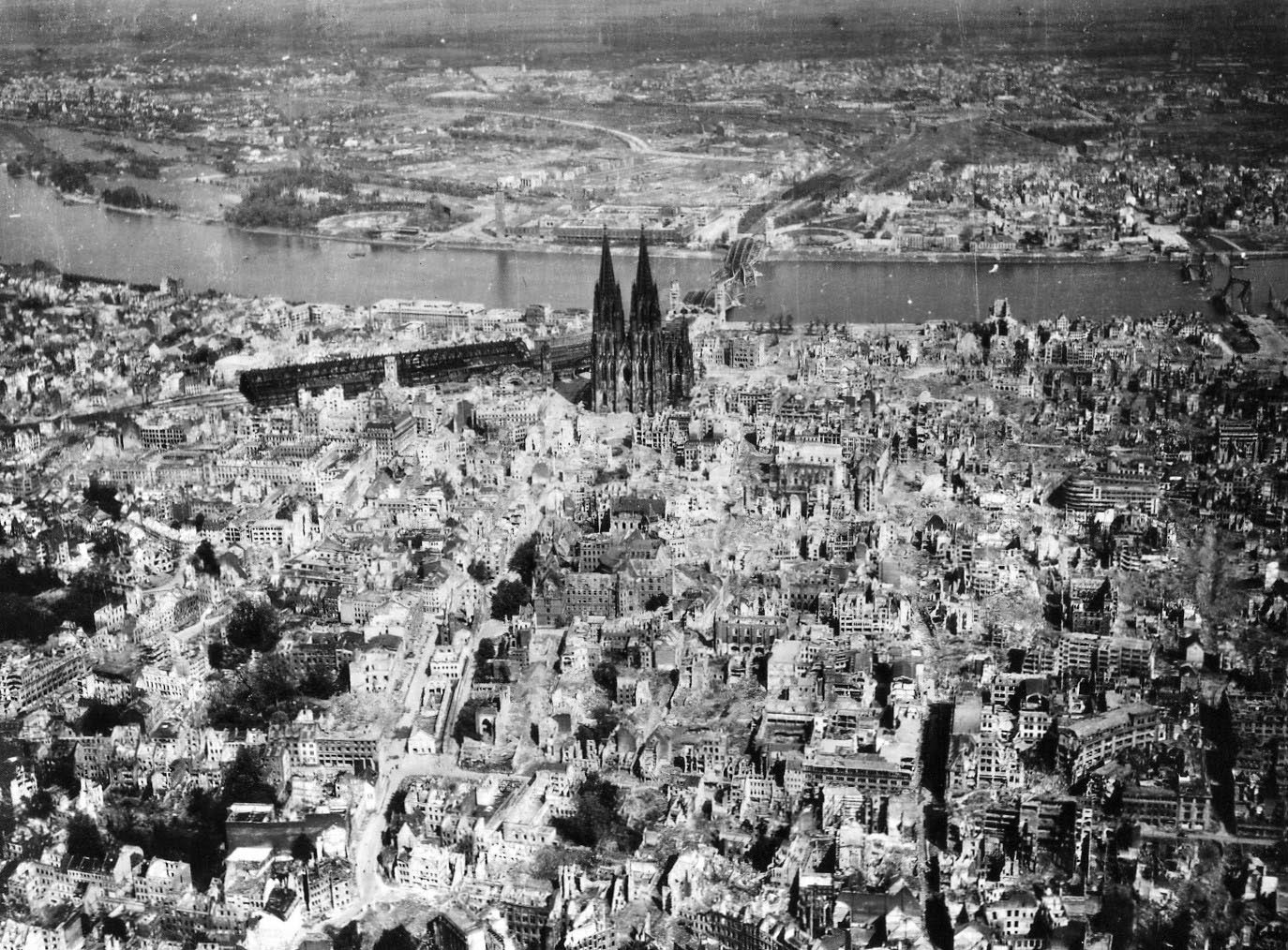 the cologne cathedral stands tall amidst the ruins of the