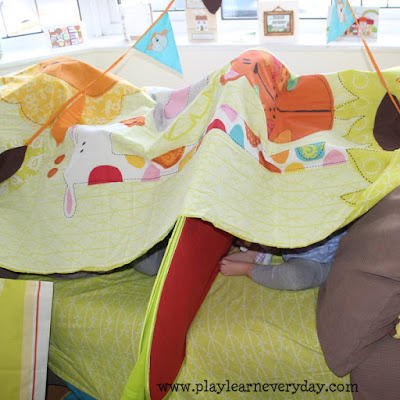 The bunting made a fabulous decoration for our fort as well as holding it up! I tied each end to the duvet cover and hooked it over a window handle. & Making Blanket Forts - Play and Learn Every Day