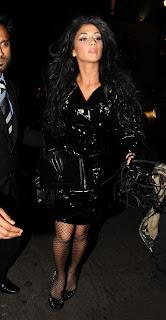 Nicole Scherzinger looking hot in fishnet stockings