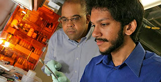 Physicist James Dickerson, left, and graduate student Saad Hasan
