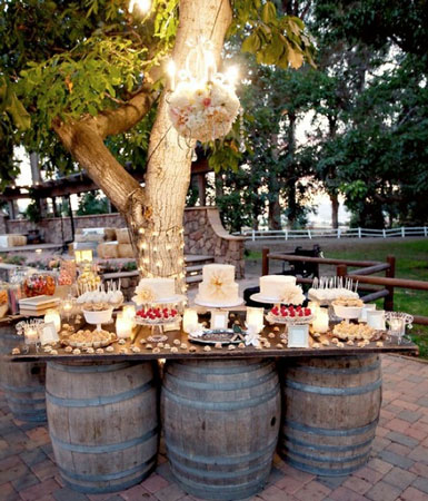 Table Decorations on Makeshift Table Using Wine Barrels   Love This  And How Amazing Is