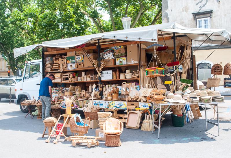 stall selling rattan woven items in a market ljubljana, slovenia