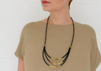 http://www.makery.uk/2015/11/diy-rubber-brass-tube-necklace/