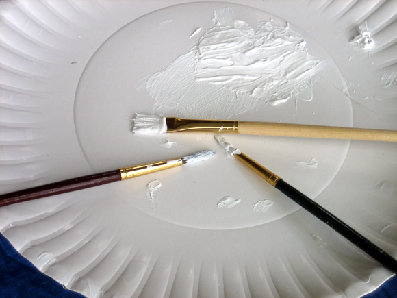 White paint and paintbrushes