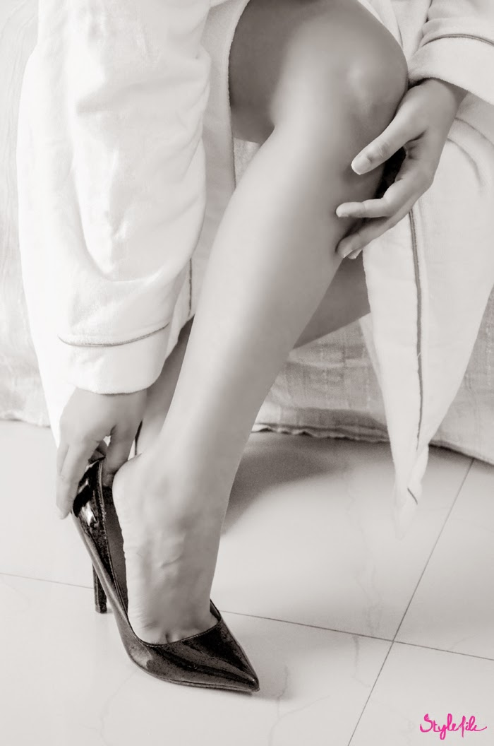 Dayle Pereira of Style File India shoots a series of black and white pictures of her legs while wearing a bathrobe and holding a mug