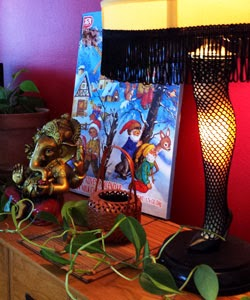 Photo of an advent calendar with a leg lamp, potted ivy, and small statue of Ganesha.