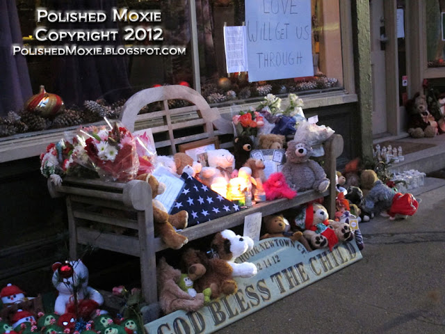 Image of bench filled with keepsakes in Sandy Hook.