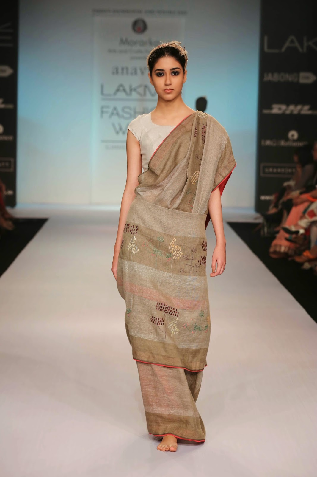"""For her debut appearance Anavila Sindu Misra took the audience at Lakmé Fashion Week Summer/Resort 2014 on an exotic fashionable journey with her collection called """"Secret Life of the Forest"""". Keeping hand-woven, linen as the basic fabric choice, Anavila used Jamdani weaves, hand batik, Sujani, Khatwa and hand block printing to add glamour to the saris."""