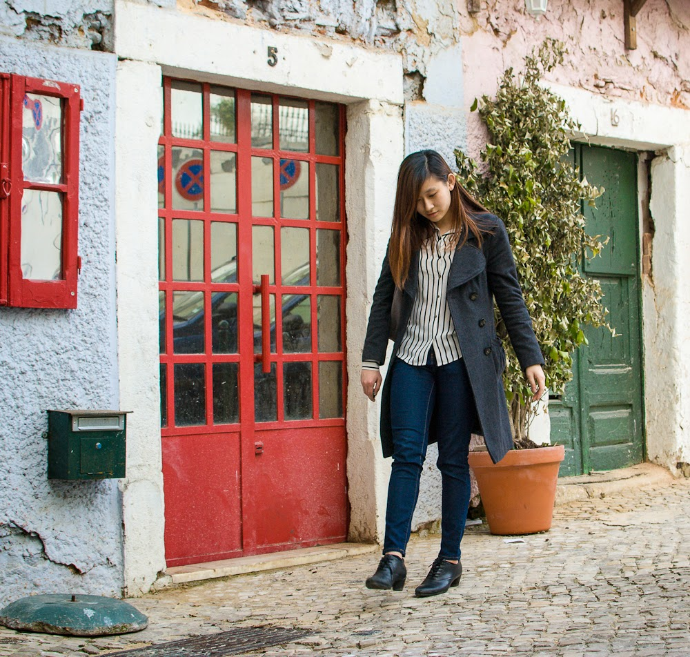 striped top and denim jeans outfit in lisbon