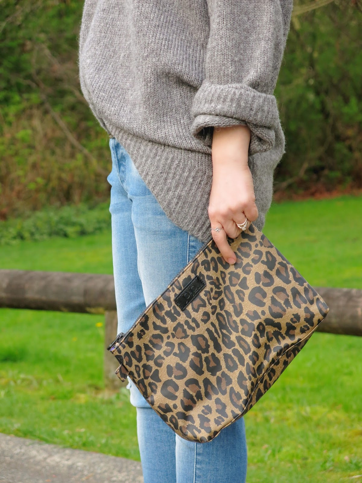 oversized grey sweater and leopard clutch