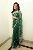 Ragini Dwivedi Glamorous photos in Green Saree-thumbnail-5