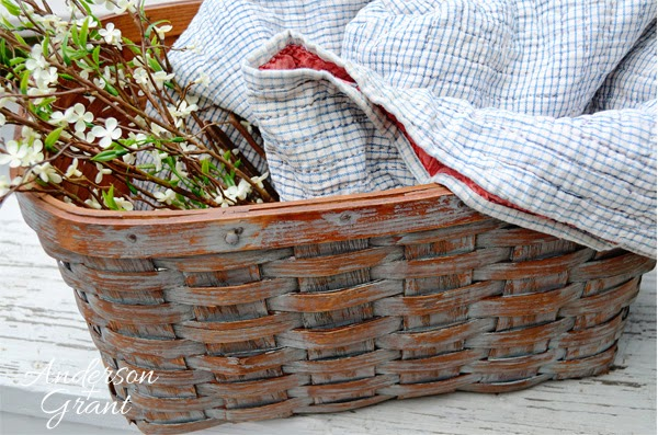 This great decorative basket was made by removing the lid and handles from an old picnic basket.....Now it is a great storage place for a quilt, some magazines, or flowers!  | www.andersonandgrant.com