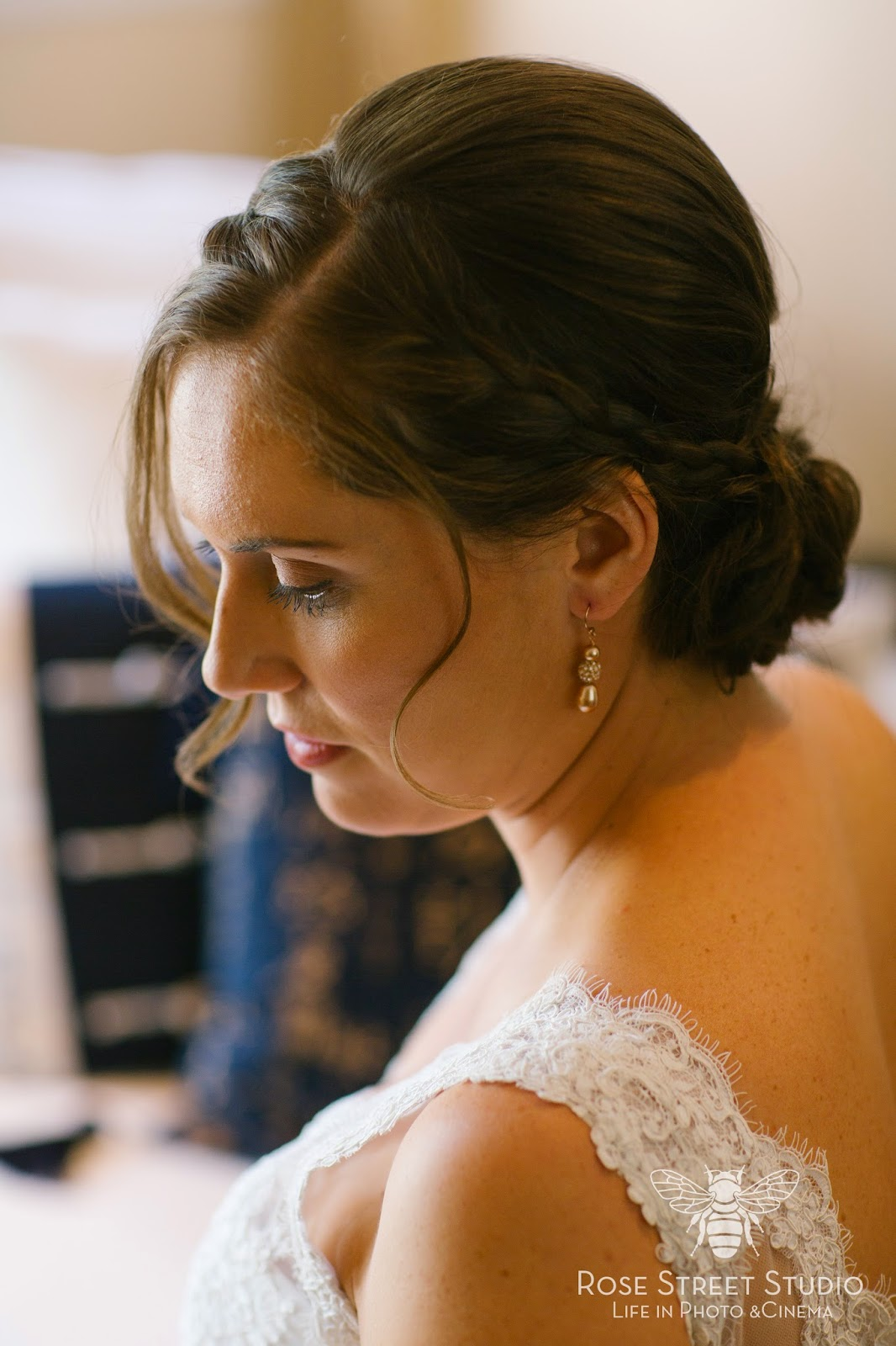 Bridal Updo with braids and face framing pieces l Rose Street Photo l Take the Cake Event Planning