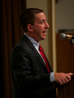 Glenn Greenwald speaking at lectern