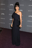 Salma Hayek looking hot in a black gown on the purple carpet