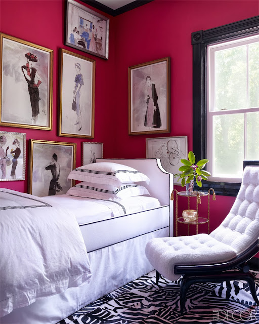Pink guest bedroom in Oscar PR Girl's weekend home with vintage fashion sketches and a custom printed hide rug