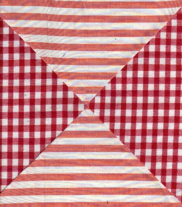 Quilt block in red stripes and checks shows different color background