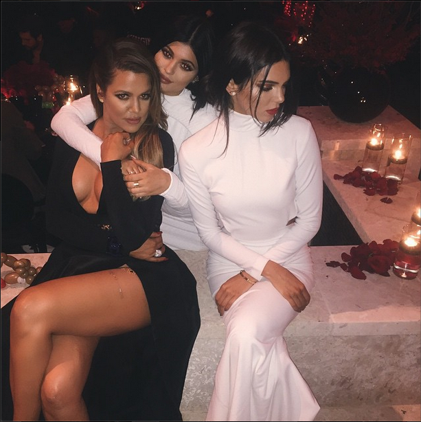 Khloe Kardashian poses with low-cut sisters Kendall and Kylie Jenner